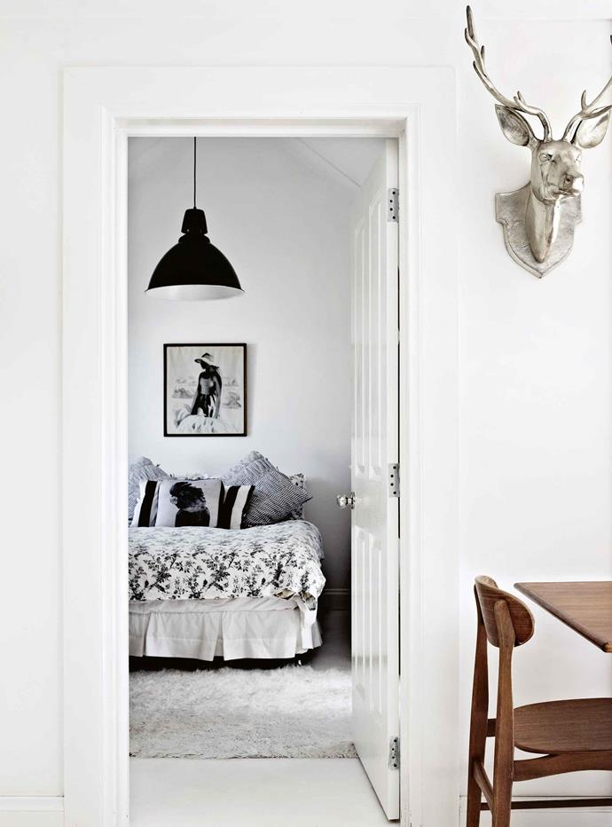 Looking from the kitchen into the main bedroom, another print by Sukke Hansen forms a focal point.