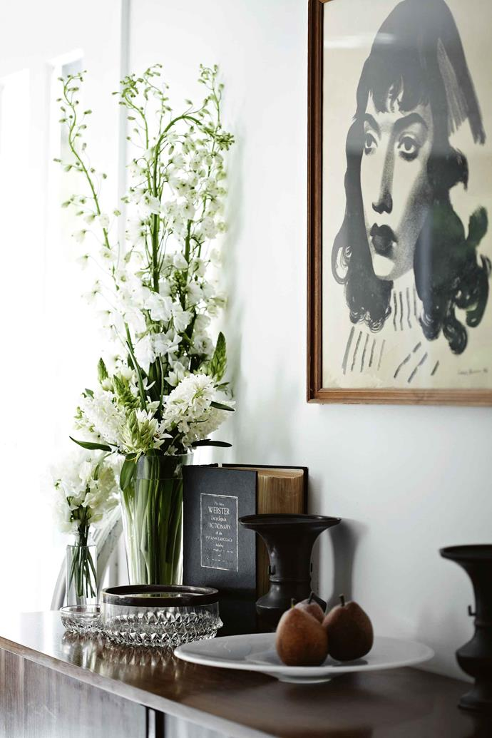 """A collection of cut glass and two 19th-century oriental bronze urns sit on a 1960s Danish [sideboard](https://www.homestolove.com.au/buffets-sideboards-australia-19913