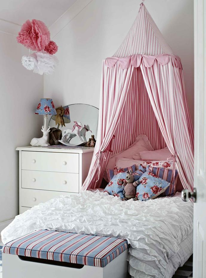 Eliza's bedroom features a cosy Cath Kidston tent canopy.