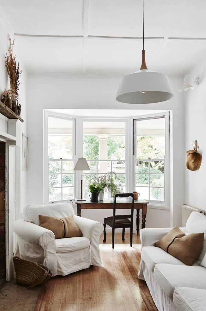 "This 1930s [farmhouse in Victoria](https://www.homestolove.com.au/a-1930s-farmhouse-mixes-old-and-new-13837|target=""_blank"") has been beautifully renovated to create a true sense of space. The bay window allows for ample light to flood into the study area."