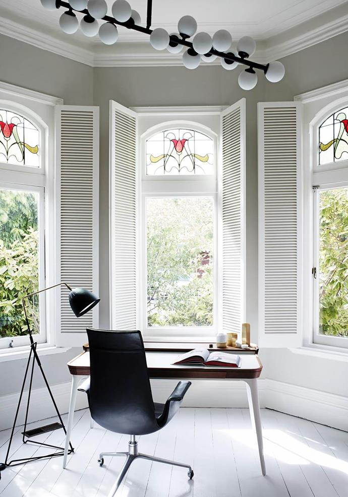 "The original bay windows with leadlight glass add a timeless element to the study area in this [Melbourne home](https://www.homestolove.com.au/home-refreshed-with-feminine-aesthetic-melbourne-19240|target=""_blank"") that has been revamped by Simone Haag and Angela Harry."