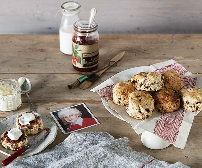 Date scones on a tray with jam and cream