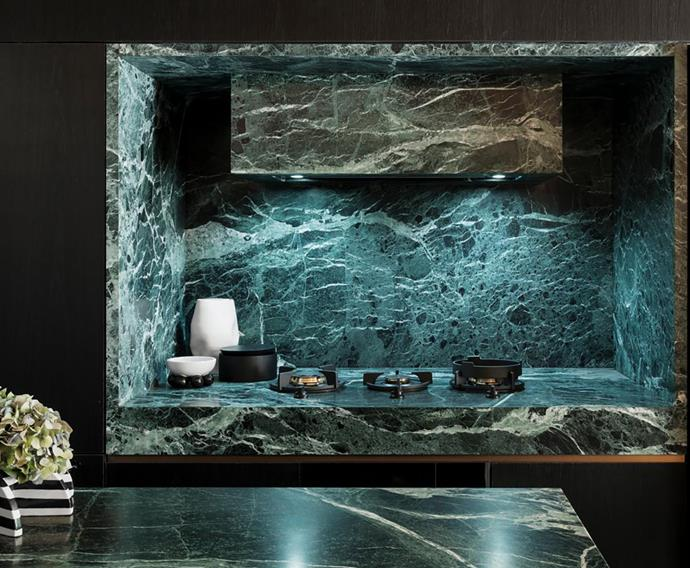 Verde Alpi Italian marble from Euro Marble makes a dramatic display in the kitchen, cladding benchtops, splashbacks and the rangehood.