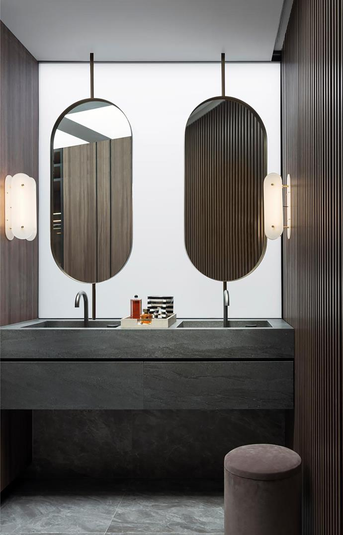 In the main ensuite, 'Arch' wall lights from Douglas and Bec, 'Eccentric' tapware from Rogerseller, Italian porcelain tiles from Cerastone, and 'Tabou' suede pouf by Michaël Verheyden.