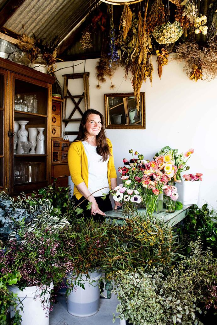 Sophie in the shed that houses her workspace. The abundant greenery — jasmine, silver gum, ivy, pittosporum and more — will give structure to her garden-flower arrangements.