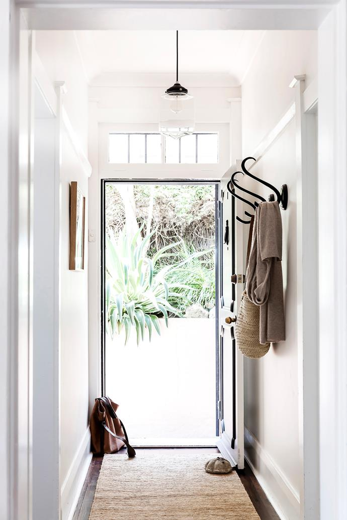 "**Entryway:** If you have a [small entryway](https://www.homestolove.com.au/small-entryway-ideas-20252|target=""_blank"") or long or narrow hallway, opt for a clear pendant that's not too obtrusive. A simple design that shows off the bulb will make a statement in a contemporary or classic home. For simple storage that keeps the floor clear, you can't go past a set of wall hooks"
