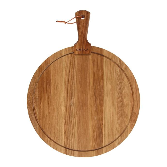 "**GRAZING TABLE PLATTER**<p> <P>[Putting together the perfect grazing table](https://www.homestolove.com.au/grazing-table-style-tips-16479|target=""_blank"") starts with a good foundation, which is exactly what this round oak serving board by Boska is. This platter's good looks will make it a constant kitchen accessory and ideal for serving home-cooked pizzas in a pinch.<p> <p>Large round oak **serving board**, $117, from [Amara](https://fave.co/2ZvBgmR