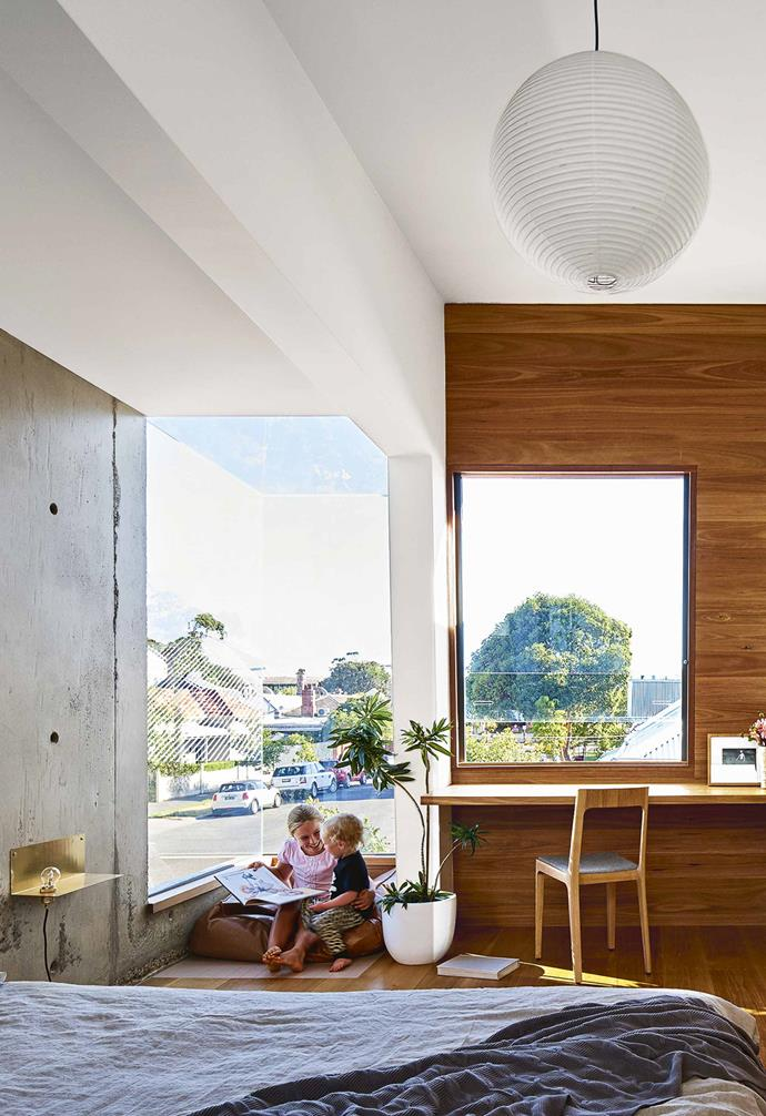 """When we got up there, we realised that there was all this open space out onto the street and we proposed the glass corner so the space on that side of the room isn't contained at all.""<BR><BR>The playful lookout keeps the family in touch with their surrounds. ""We have an incredible view and have such a read on the community and what's going on,"" says Danika. ""It's beautiful.""<br><br>**Bedroom** The upstairs bedroom is kitted out with joinery by David Elliot of Design Excellence to create a multi-functional space that can be reimagined as a living space down the track. ""The texture of the concrete and timber has a lot of warmth,"" says Danika. The glass corner acts as a lookout to the street. ""I [had blinds measured for that room](https://www.homestolove.com.au/how-to-choose-blinds-19774