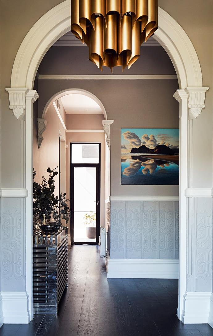 The entryway showcases an original archway. The pendant light was supplied by the clients from RH Modern.