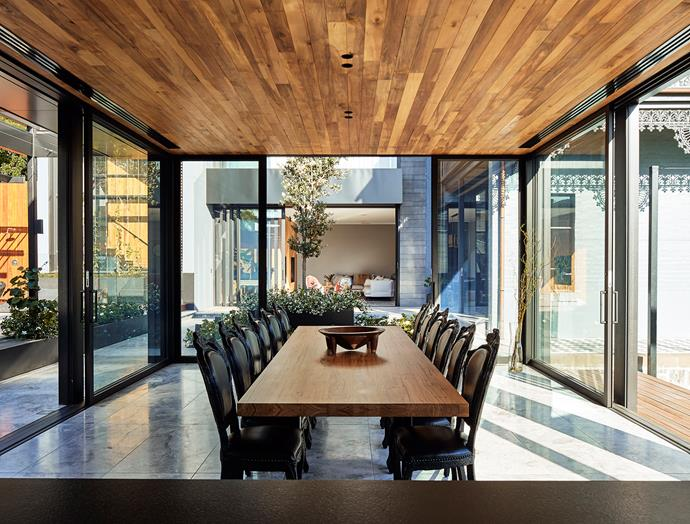 The pool pavilion houses another dining space that can be opened up via the floor-to-ceiling sliding doors.