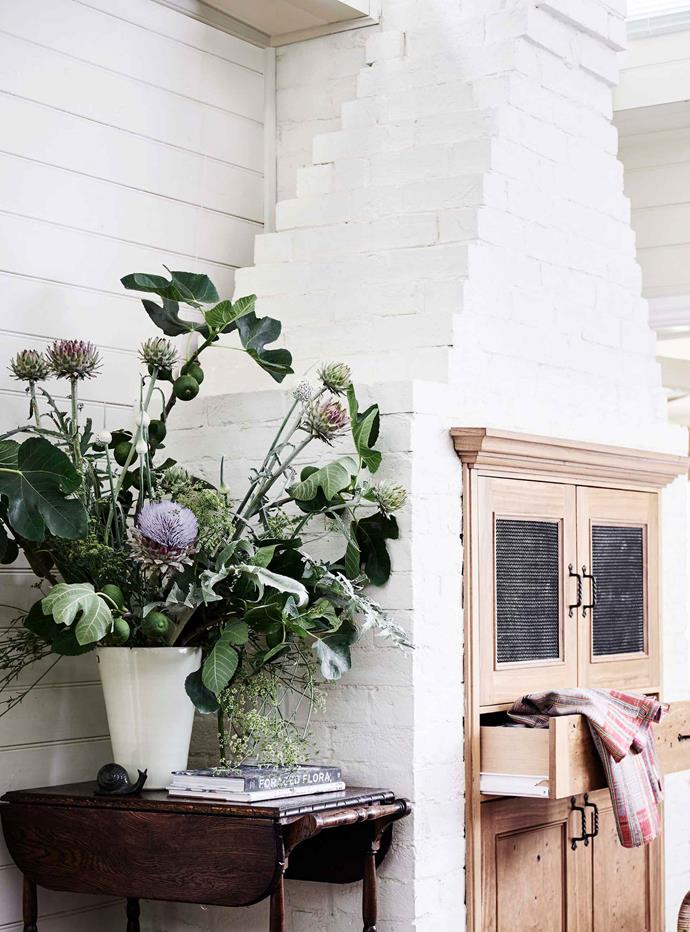 """It was really sad to knock the old kitchen down,"" says Margot Shannon. ""The fireplace remains but is purely ornamental. I decorate it with fruit and flowers from the garden."""