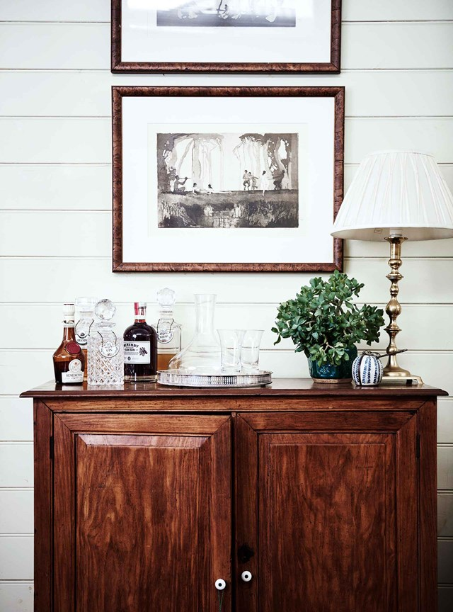 A collection of crystal glassware has been styled to create an elegant drinks cabinet with vintage charm.