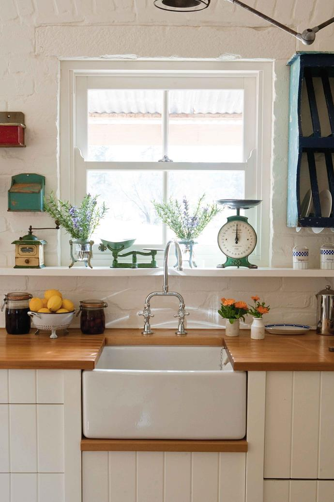 Vintage pieces, from scales to a coffee grinder, keep the kitchen in period.