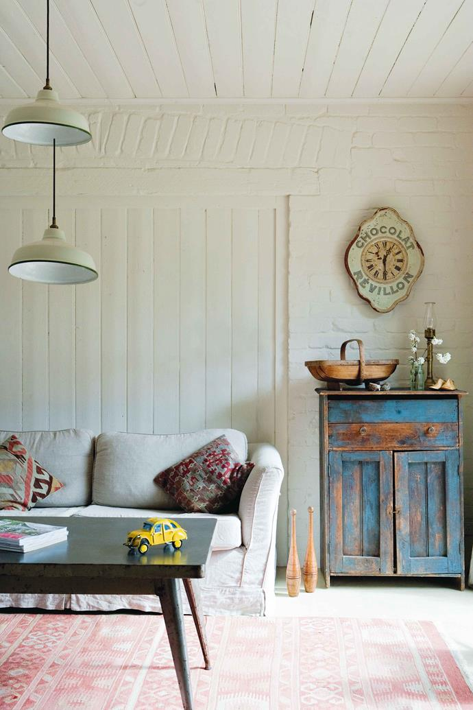 The couple's differing preferences result in an eclectic mix of European and early-Australian antiques, including French industrial furniture and lighting, and Depression-era pieces.