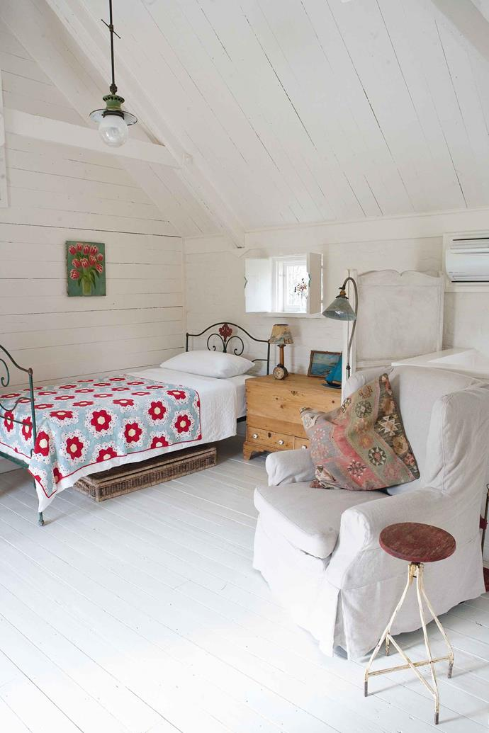 Glenny made the patchwork quilt that brightens the all-white loft bedroom.