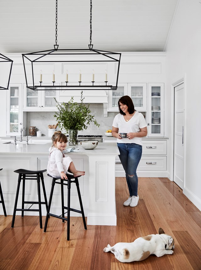 "In this family [home in the Southern Highlands](https://www.homestolove.com.au/family-home-with-character-in-the-nsw-southern-highlands-20547|target=""_blank"") a Hamptons style kitchen bench was created with detailed joinery, large-scale proportions and a classic Ceasarstone bench in Noble Grey. """"We opted for an all-white kitchen because it always feels bright and fresh,"" says homeowner Brielle."