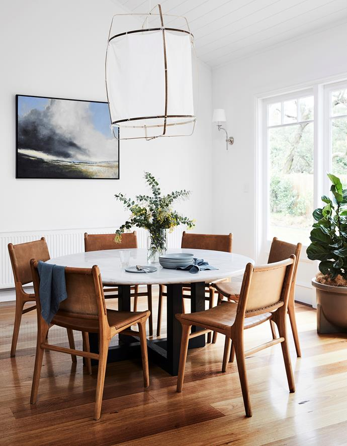 """The leather is so practical and comfy for family meals,"" says Brielle of the Tanner dining chairs from Barnaby Lane. Ay Illuminate Z1 pendant light, Suzie Anderson Home. Flooring is southern beech. Napkins, Busatti. Dinnerware, Studio Enti. Artwork by Peter Watts, Art2Muse Gallery. Local hero: Global Marble dining table, $3375, MCM House."