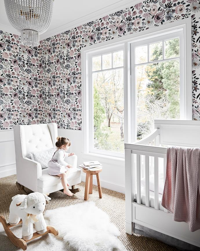"""""""I wanted it to be feminine and sweet but bold,"""" says Brielle. Aerin Lauder chandelier, The Montauk Lighting Co. Rug, Armadillo&Co. Wingback rocker and plush lamb rocker, both Pottery Barn Kids. Smart buy: English Garden removable wallpaper, about $264/double roll, Caitlin Wilson."""