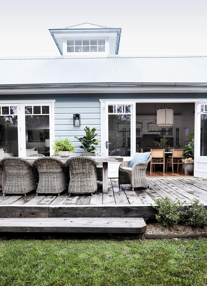 Brielle and Andrew love to entertain, so they designed two sets of oversized french doors connecting the living areas with the 12x4m deck to allow crowds to spill outdoors. Decking timbers are century-old ironbark. Granada dining table, Globe West. Toronto chairs, La Maison.