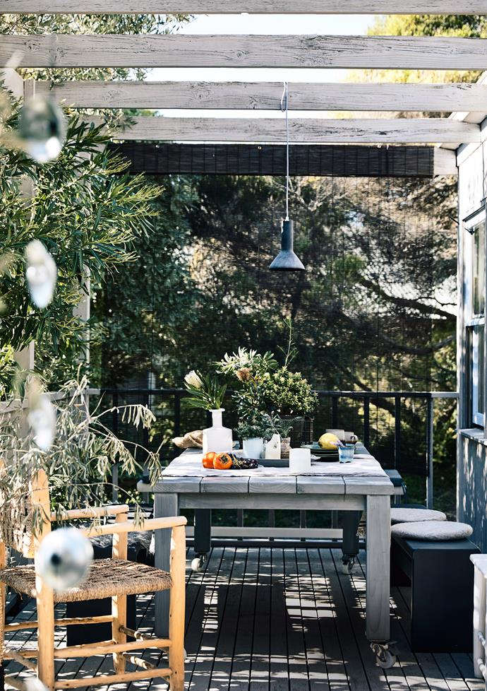 If you're blessed with more balcony space, bring a table outdoors to create an inviting alfresco dining area.