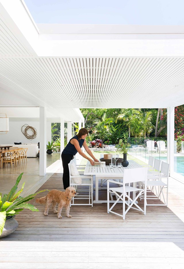 "Stacking doors slide away to connect this breezy [beach cottage in Avalon](https://www.homestolove.com.au/fibro-cottage-avalon-20548|target=""_blank"") with its covered entertaining area and pool. Creating a seamless indoor-outdoor connection allows for effortless entertaining with the kitchen, bathroom and main living spaces close by."