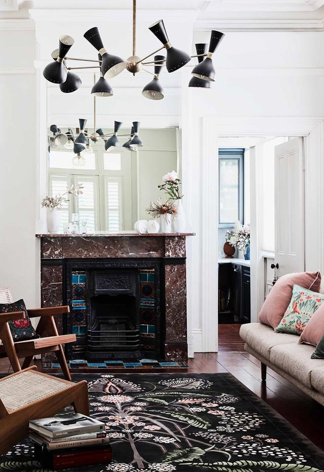 "A former set and costume designer turned homewares curator uses her [newly renovated home](https://www.homestolove.com.au/italianate-victorian-home-19959|target=""_blank"") as the perfect backdrop for her collection of Australiana-inspired goods. The Wattle Delight rug from Designer Rugs, printed cushions from House of Heras and Jardan velvet and linen plain cushions add colour and pattern to this space."