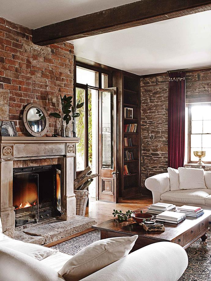 """During the renovation, they managed to retain many original features, including the windows and the living-room fireplace, which had been replaced with a gargoyle-adorned concrete surround. """"We found the original surround in the old stable under dirt and hay, and so we dragged it up to the house, cleaned it up, and reinstated it."""""""