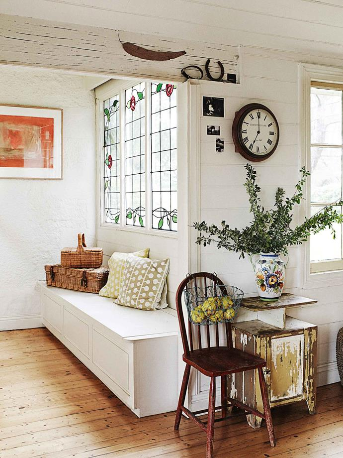 """A painting by Sydney's Peter Griffin hangs above a window box that the twins made: """"You can never have enough storage,"""" declares Simmone. The living room surfaces were stripped back to expose the original [rammed-earth walls](https://www.homestolove.com.au/tour-this-eco-friendly-rammed-earth-house-in-south-africa-17544 target=""""_blank""""). """"As you go up the wall,"""" says Simmone, """"you can see where the original builders might have stopped for a couple of months, and then restarted with a different sort of mud."""""""