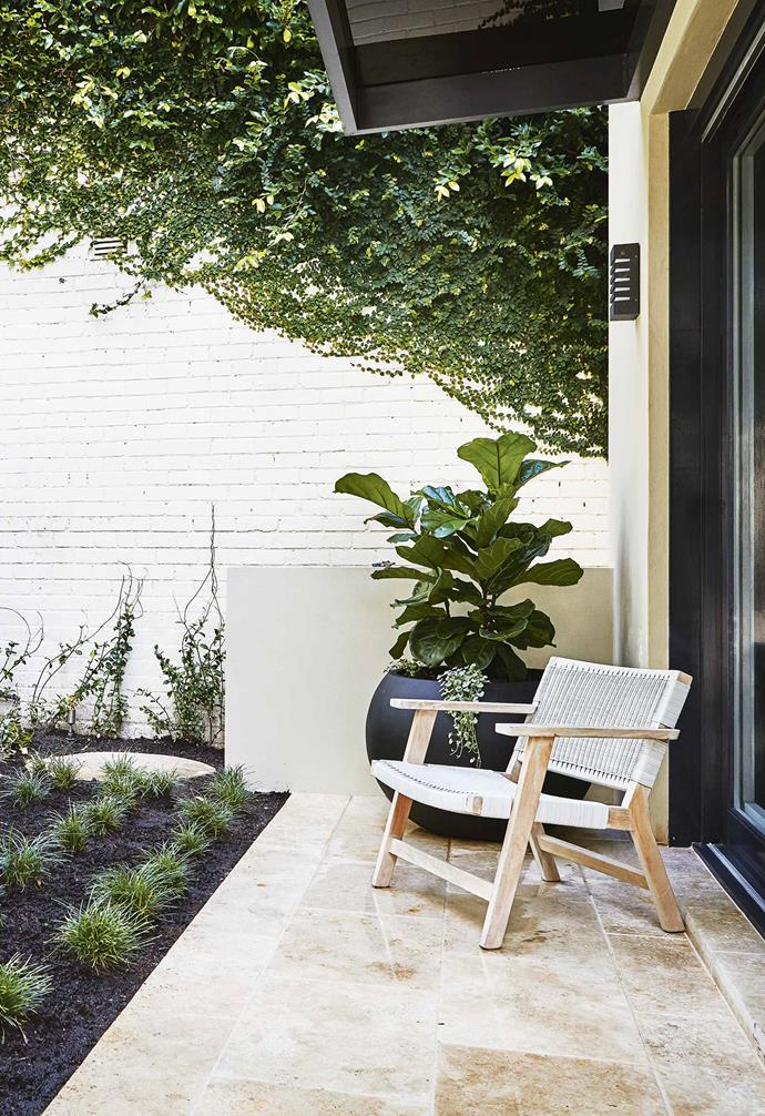 """The [travertine tiling](https://www.homestolove.com.au/outdoor-surface-ideas-15094