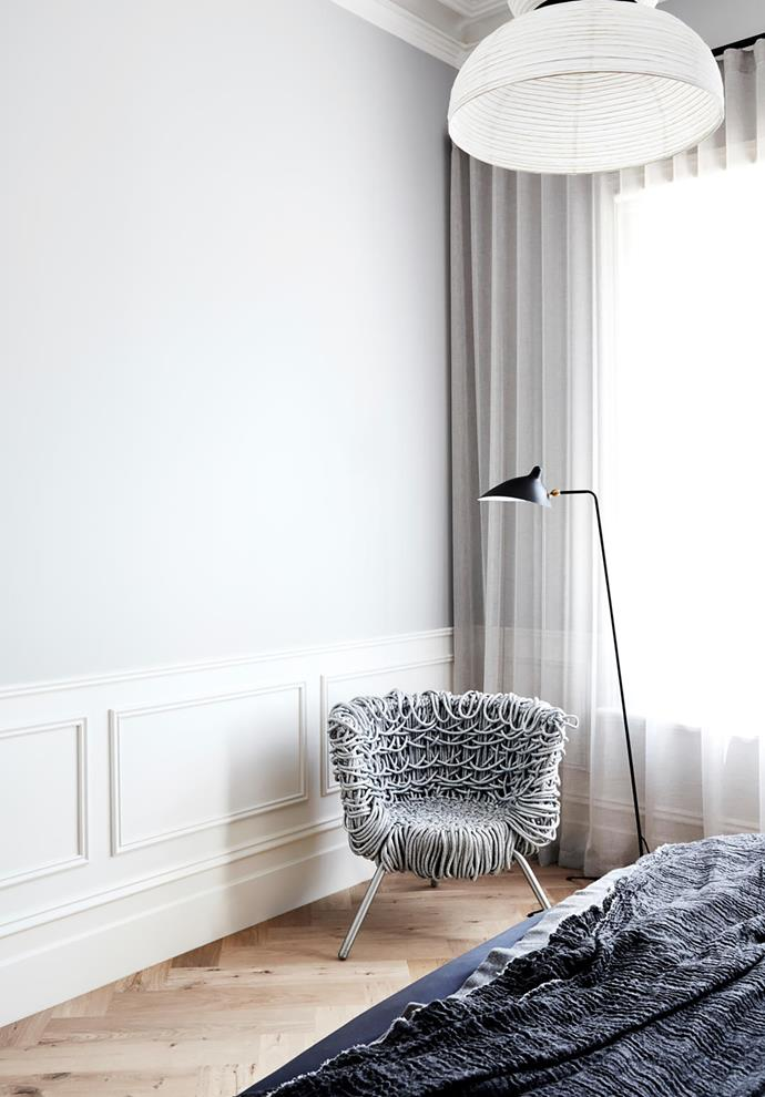In the bedroom, Edra 'Vermelha' armchair from Space and Serge Mouille 'Droit' floor lamp beneath an &Tradition 'Formakami' rice paper pendant light by Jaime Hayon.