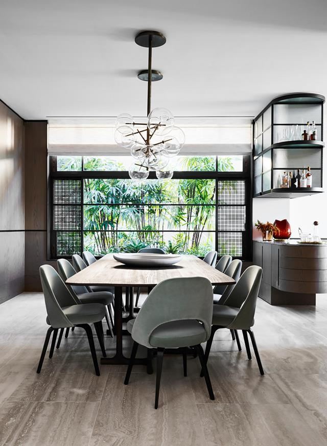"""This formal dining room can be completely closed off with sliding doors to provide a quiet and [sophisticated retreat](https://www.homestolove.com.au/elegant-family-home-with-show-stopping-views-20493
