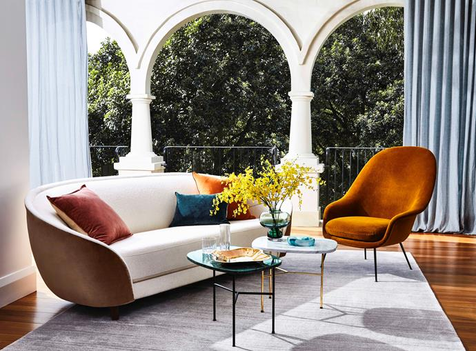 Gubi 'Revers' 2.5-seater sofa, $9695; 'Bat' lounge armchair, $5495. Rug Culture 'Havannah ' rug in Natural, $1699. Mulberi 'Montpellier' velvet cushions in Nutmeg and Marsala, $89.95; 'Sovereign' velvet cushion in Pine, $79.95. Bolia 'Pod ' coffee table in Grey, $1195; 'Pod ' coffee table in Green, $1195. Dinosaur Designs small 'Earth Bowl ' in Lagoon, $90. Riedel 'Drink Specific' Rocks glass set of 2, $49.95, Fizz glass set of 2, $49.95.