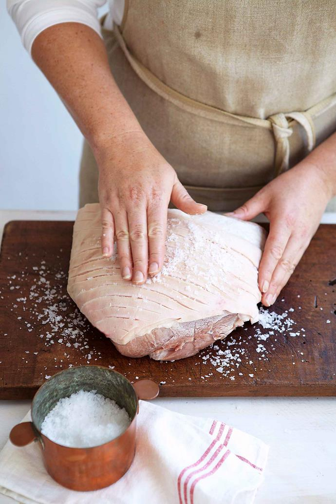 To ensure the crispiest pork crackling, score the rind first and rub with salt.