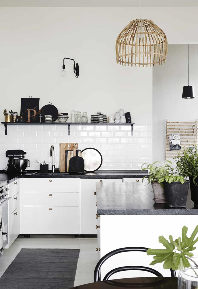 **Kitchen** The family chose unfussy white cabinets, black benchtops and subway tiles.