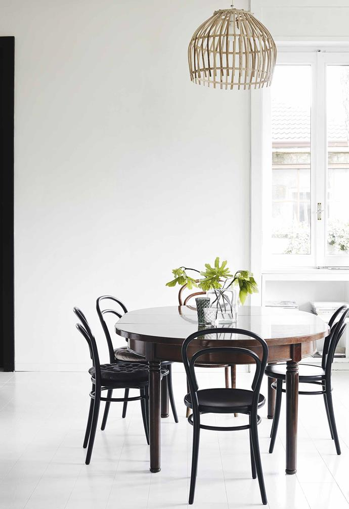 **Casual dining** A polished vintage table and Thonet chairs give this family space a sophisticated edge.