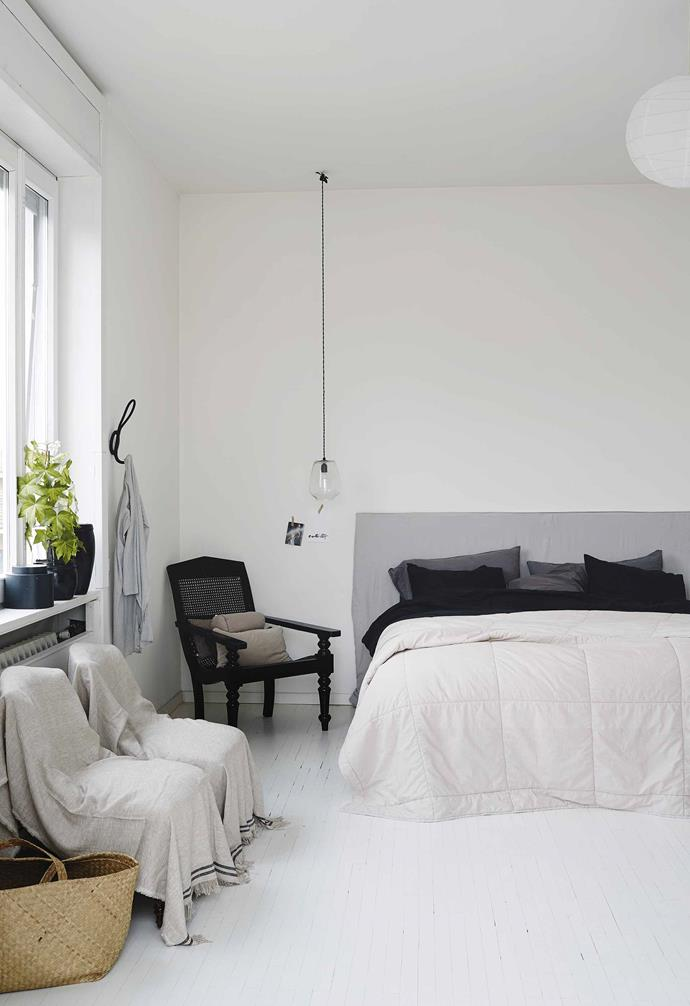"**Main bedroom** Annemo made the bedhead in this elegantly sparse room. The linen is from H&M Home and the black rattan chair was a secondhand find. Glass pendant light, from a discontinued range at [Tine K Home](https://www.tinekhome.com/|target=""_blank""