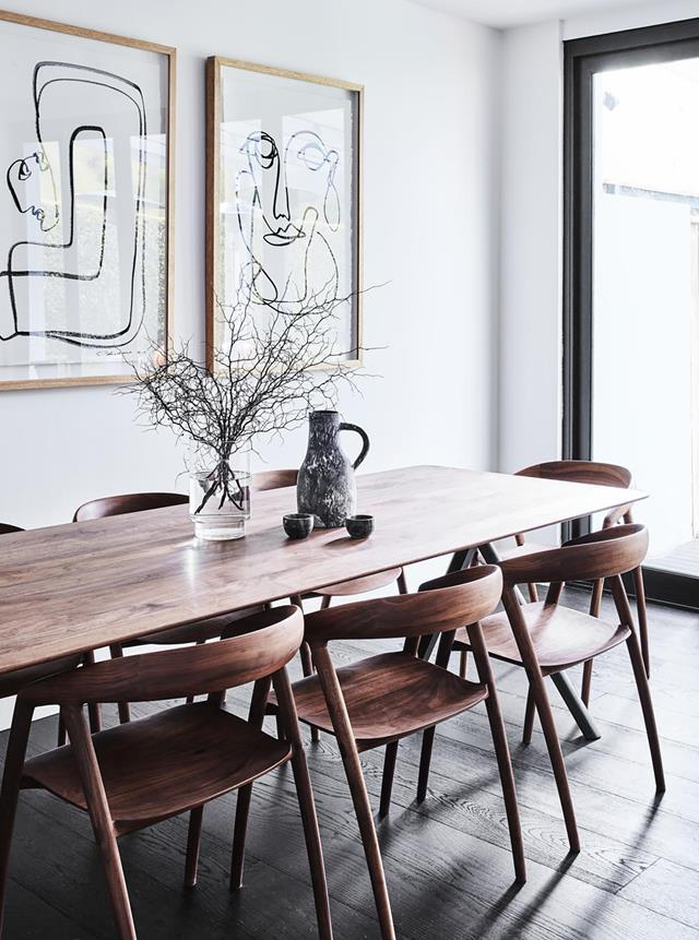 A refresh of a Federation townhouse in Sydney became a full interior design project for Melissa Koch. The old maple wood floors were replaced with European oak stained in a dark finish and changed the beige walls for a calming grey that provided a clean palette for the art. *The Theory of Everything* and *She Understood Herself* artworks by Christine Spangsberg from Jerico Contemporary hang on the dining room wall. From *Belle* February/March 2019.