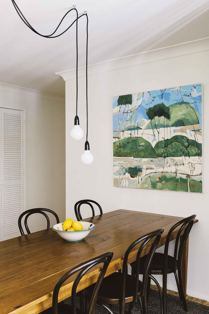 The dining room features a kauri pine table from Original Finish, No 18 Bentwood chairs in dark oak from Thonet and a painting by artist Ivonne Mace.