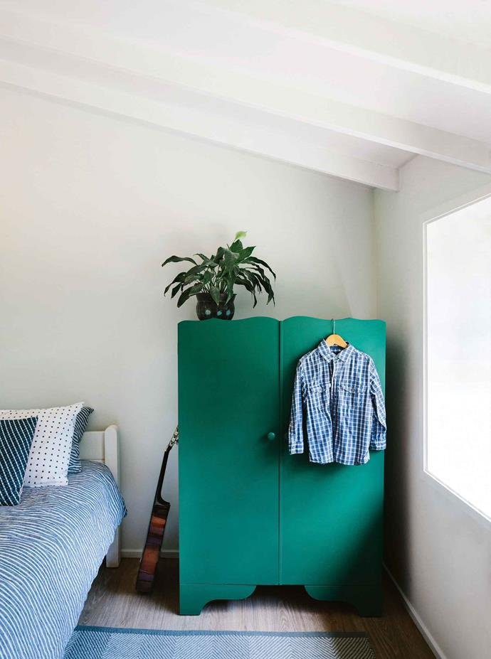 A retro cupboard picked up second-hand and painted green makes a statement in Harry's room off the verandah.