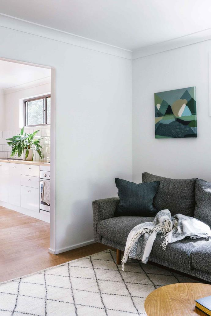 "The sitting room has been spruced up with a coat of Dulux Whisper White paint. The two-and-a-half seater 'Errol' couch from Jardan sits under the Stay painting by [Belynda Henry](https://www.homestolove.com.au/secluded-coastal-house-13544|target=""_blank"")."