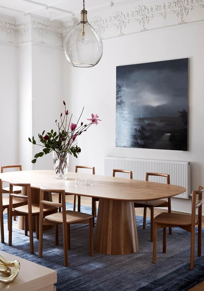 "Mardi Doherty put a contemporary spin on this [grand old home](https://www.homestolove.com.au/a-restored-edwardian-home-by-mardi-doherty-design-5932|target=""_blank""). In the dining room,  a modern dining setting complements the original period features. Artwork: *The End of Town* by Darren Gannon from Franque. From *Belle* October 2017."