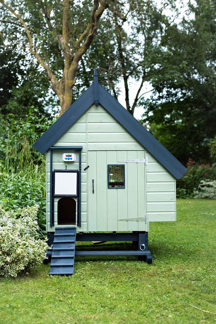 A chicken coop with an automatic door.