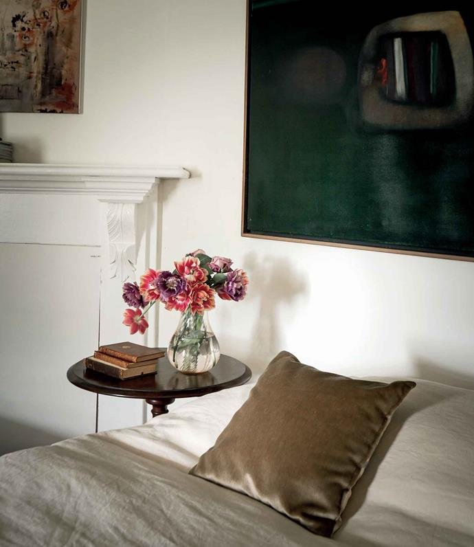 In a bedroom hangs a painting by Lindsay Edwards.