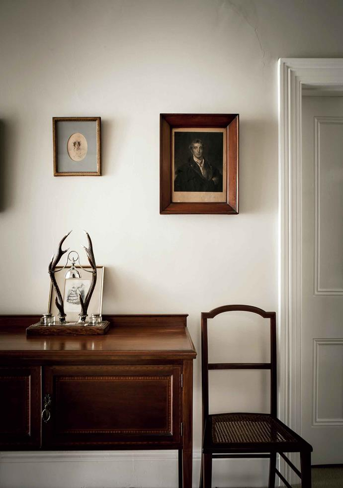 In the hallway a portrait of a woman painted by an unknown Tasmanian artist hangs near an etching of the Duke of Wellington; and below is a framed page taken from a 19th-century French journal.