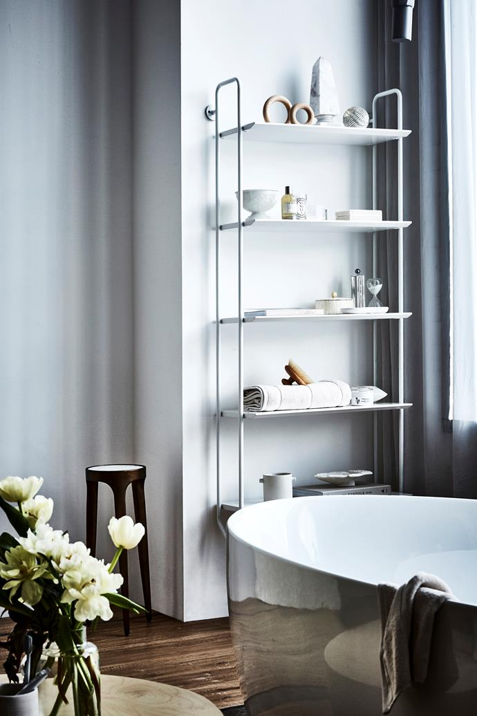 Fill a shelving unit with little vignettes of beauty tools, vessels, perfumes or shells in between folded towels.