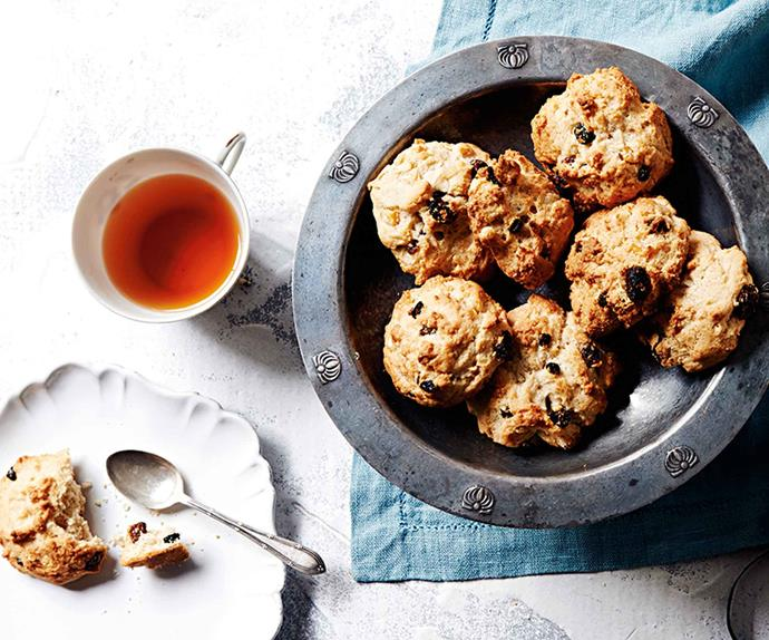 Rock cakes on a plate with a cup of tea