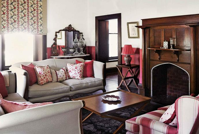"The [formal sitting room](https://www.homestolove.com.au/formal-living-rooms-20549|target=""_blank"") — the 'raspberry room' — is Genevieve's favourite. Three custom-made French-style couches frame the fireplace. Walls have been painted in rich stripes to dado height, and family photos and mementoes create an intimate feeling. ""I just keep adding things,"" she confesses."