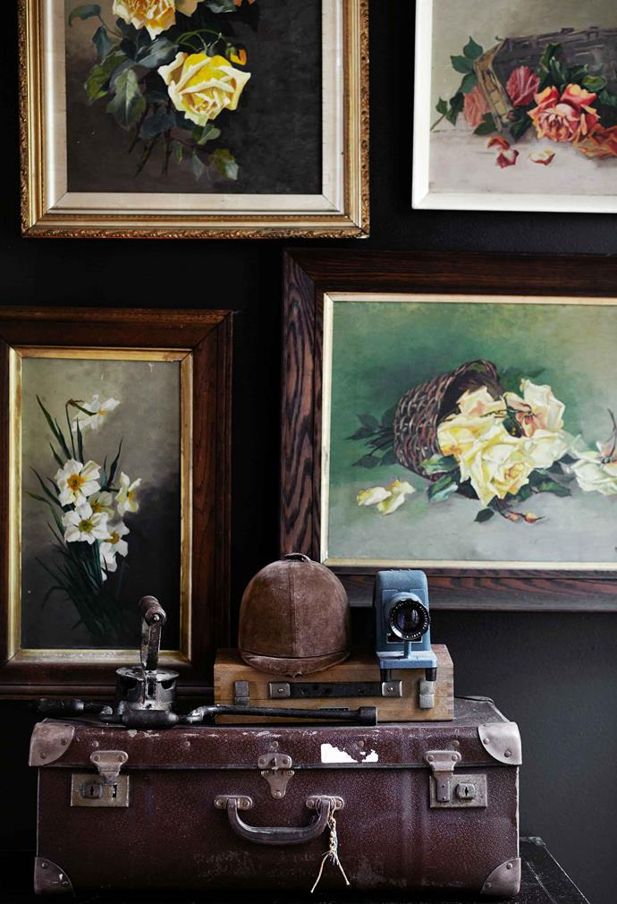 A series of floral paintings that was purchased at a Sydney auction.