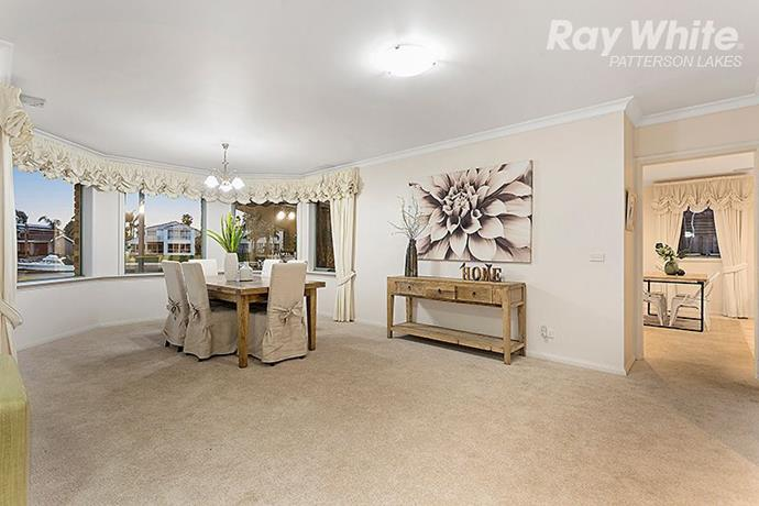 """The formal dining room features a [bay window](https://www.homestolove.com.au/bay-windows-20526