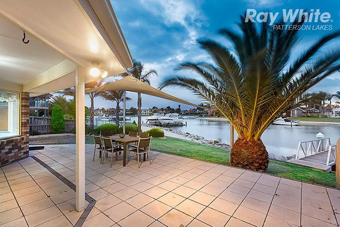 The backyard has uninterrupted water views, and access to a private beached area and jetty.